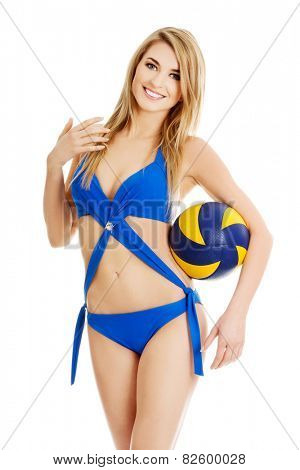 Young woman in swimsuit holding a ball