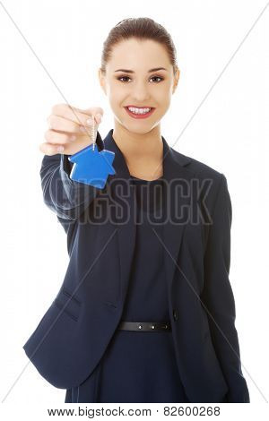 Smiling businesswoman holding a keychain
