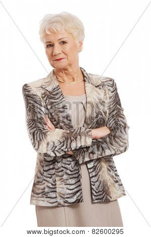 Friendly senior woman with folded arms