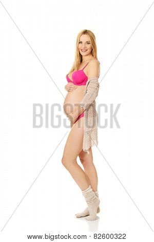 Well groomed pregnant woman in lingerie and socks
