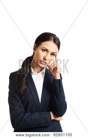 Businesswoman tired because of troubles looking at the camera.
