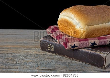 loaf of bread on Bible