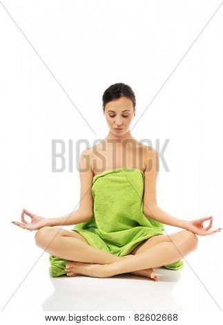 Front view woman sitting excercising yoga.