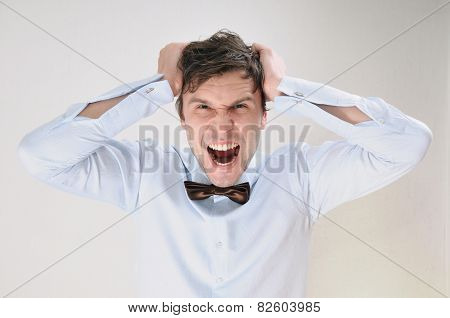 Emotional Portrait Of Attractive Screaming Man On White Background