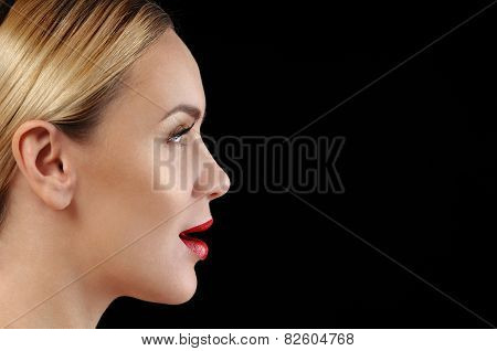 Beautiful Young Woman With Sensitive Skin And Perfect Makeup In Profile On Black Background