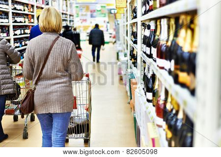 Woman With Cart In Supermarket