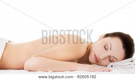 Woman lying on a towel ready to massage.