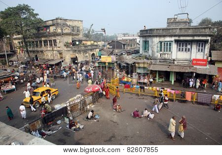 KOLKATA, INDIA - JANUARY 24: Tourists and visitors of famous Kalighat Kali Temple have rest near the shrine on January 24,2009 in Kolkata. The name Calcutta to have been derived from the word Kalighat