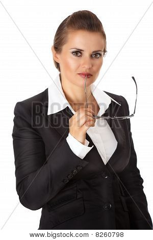 thoughtful modern business woman holding eyeglasses