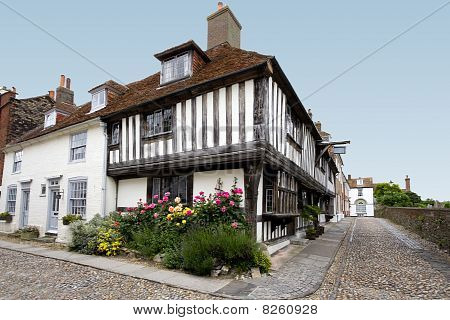 Tudor House With Flower Bed