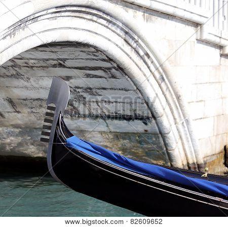 Venice, Bow Of Gondola Under The Bridge In The Waterway