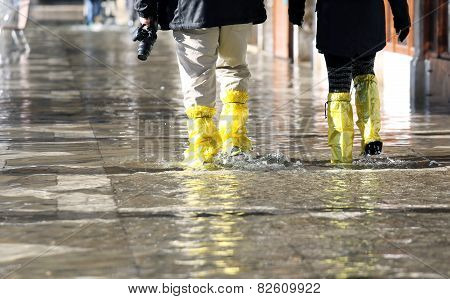 Venice Photographer With Gaiters At High Tide
