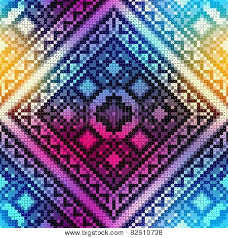 Embroidery pattern on blurred background.