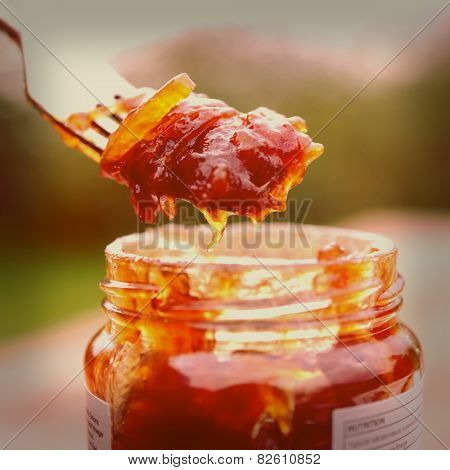 Eating onion chutney with fork, toned image