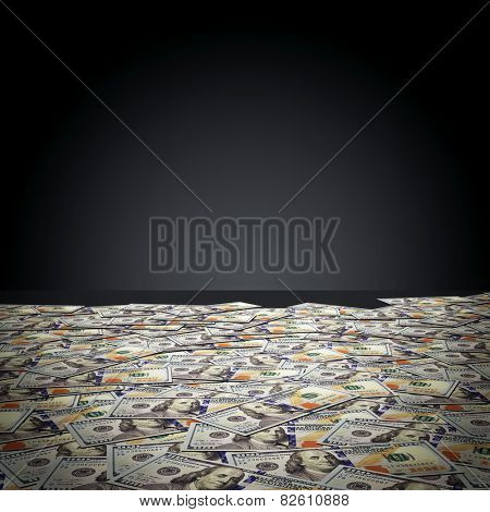 One hundred dollar banknotes against black wall. Money, finance concept