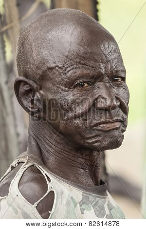 PANWELL, SOUTH SUDAN-NOVEMBER 2, 2013: An unidentified man in the village of Panwell, South Sudan wears the expression of a life of hardship.