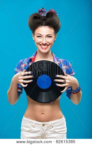 The vintage photo of girl holding vinyl record.