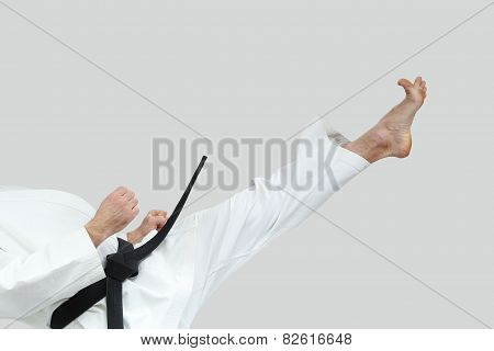 High direct blow leg is doing the athlete in karategi