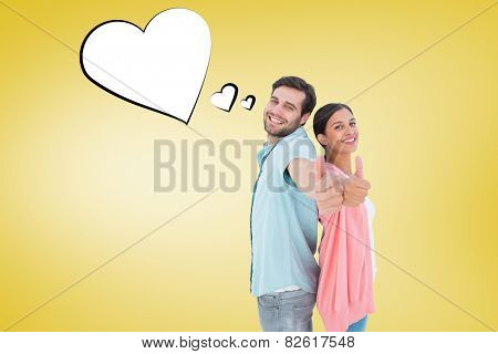 Happy couple showing thumbs up against yellow vignette