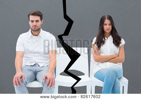 Angry couple not talking after argument against grey