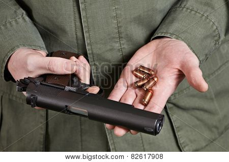 Soldier Holding Gun And Cartridges