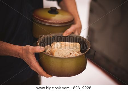 Men Holds Pan With Free Food