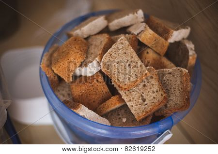 Cut Bread In  Bucket For Homeless People