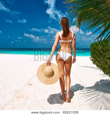 Woman in bikini on a tropical beach at Maldives