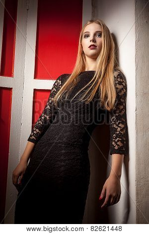 Blonde Model Looking In Camera On Red Vintage Wall