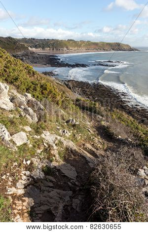 The South Wales Coast Path scrambles round the edge of a cliff near Brandy Bay on the Gower Peninsula.