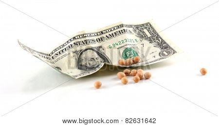 Paper money and grains isolated on white