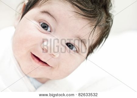 Face of happy baby smiling happiness child portrait cute smile.