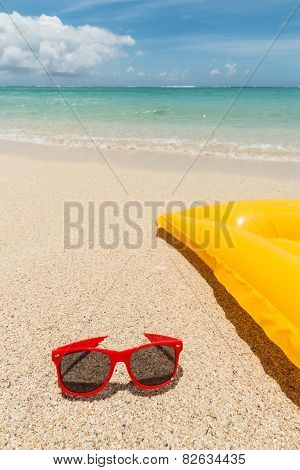 Red Sunglaasse And Air Bed