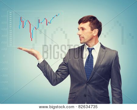 business, money and office concept - attractive buisnessman showing forex chart on the palm