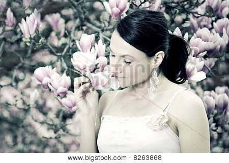Girl And Magnolia Flowers