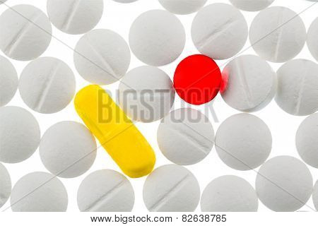 white and colored tablets, symbolic photo for medicine, medicines and painkillers