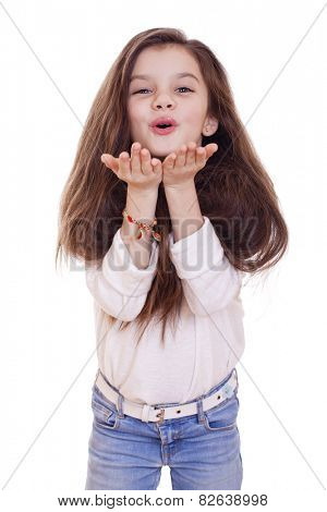Happy little Girl Blowing a Kiss, isolated on white background