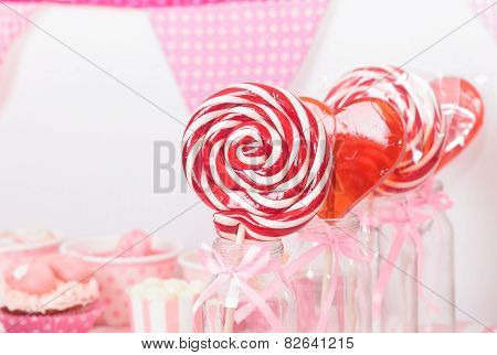 lollipops in dessert table at girls party