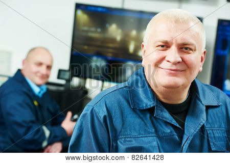 security executive chief in front of video monitoring surveillance security system team