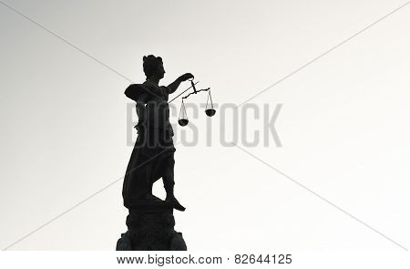 Statue of Lady Justice high contrast