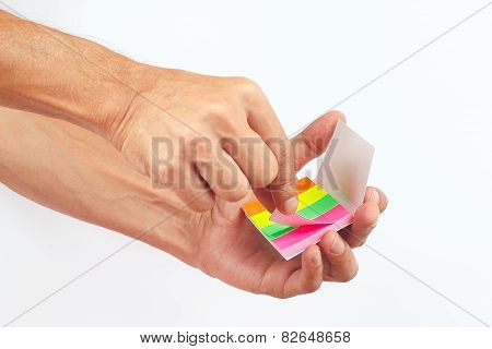 Hand with colored stickers on white background