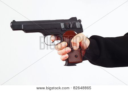 Hand with handgun on white background