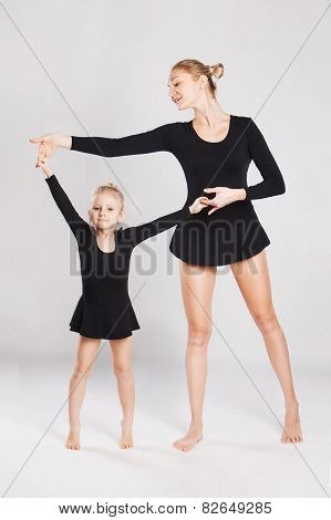 Mother with daughter gymnastics