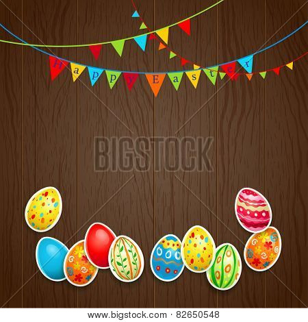 Easter eggs and flags on wood background. Holiday card with place for text.