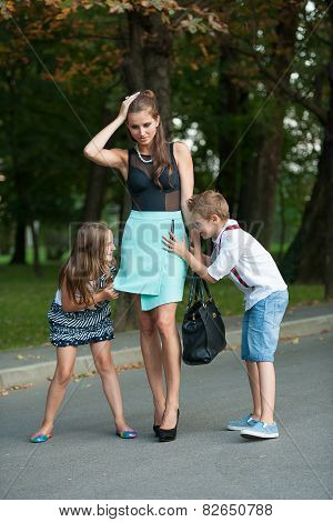 Mother With Naughti Son Adn Daughter On A Walk In Park