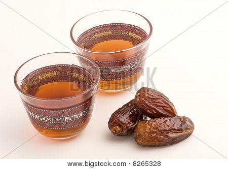 Traditional arabic tea cup and dates..