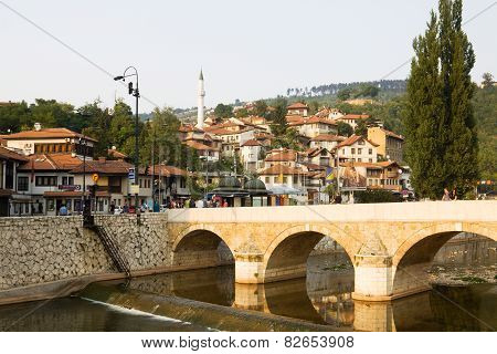 Sarajevo Cityscape With The Miljacka River And A Bridge