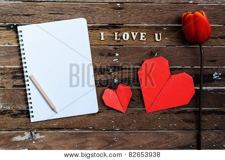 Red Tulip With Blank Notebook And Red Heart Shape