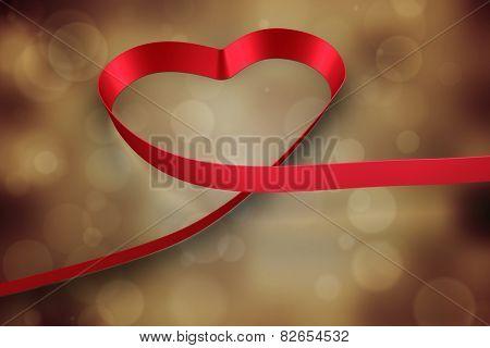 Red ribbon heart against orange abstract light spot design