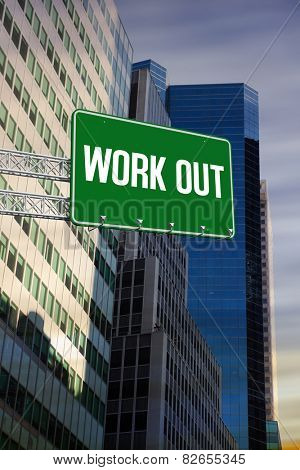 The word work out and green billboard sign against low angle view of skyscrapers